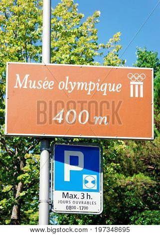 Musee Olympique Street Indicator And Parking Sign Lausanne