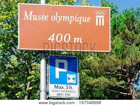 Musee Olympique Street Indicator And Parking Sign In Lausanne