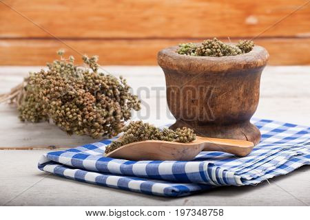 Close up of dried oregano herb inside a bowl