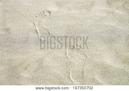 Footprints on the sand at coastline of Danang Vietnam