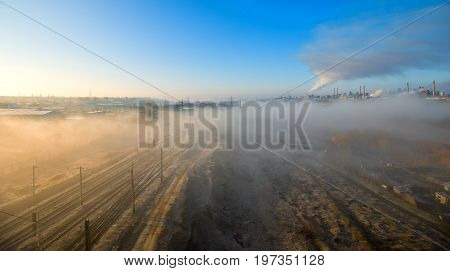 Smoke emission from factory pipes in the morning