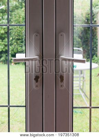 two locked backdoor handles up close garden; England; UK