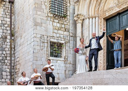Bride And Groom And Musicians At Church In Dubrovnik