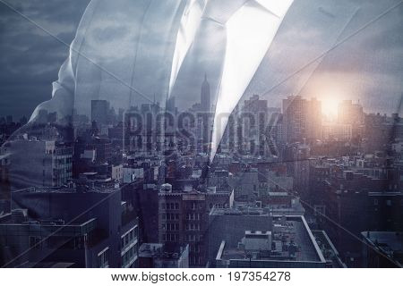 Transparent businessman on abstract city background with sunlight. Tomorrow concept. Double exposure