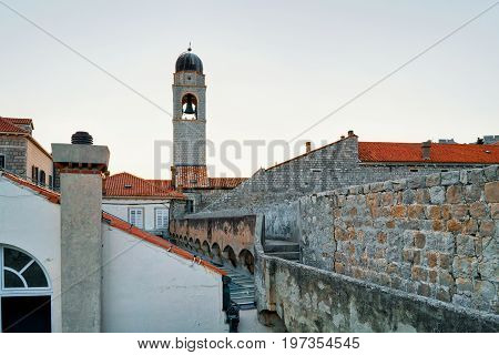 Belfry Of Franciscan Monastery And Old City Walls Of Dubrovnik