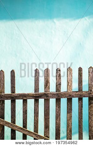 Old wooden fence the wall whitewashed by lime in sea wave color on background copy space. Ukraine