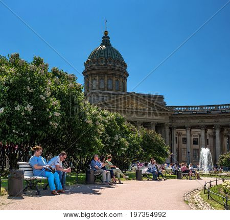 Saint Petersburg, Russia - June 17, 2017: Kazan Cathedral. In the foreground there is a park in front of the Cathedral. This cozy park before became a favorite place for meetings and recreation.