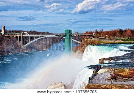 Niagara Falls And Rainbow Bridge In American Early Spring