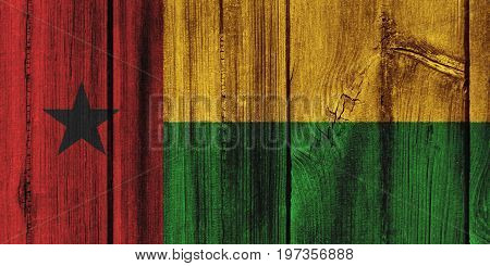Guinea-bissau Flag Painted On Wooden Wall For Background