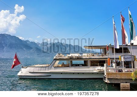 Excursion Ship And People At Pier On Geneva Lake Swiss