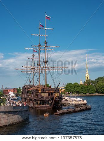 Saint Petersburg, Russia - June 17, 2017: the floating restaurant -the flying Dutchman - in the form of a sailing ship. Located on the Mytninskaya embankment of the Neva. The restaurant on the background of the fortress.
