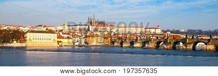 Prague Hradcany Panorama on sunny day. Charles Bridge over Vltava River with Prague Castle, Czech Republic.
