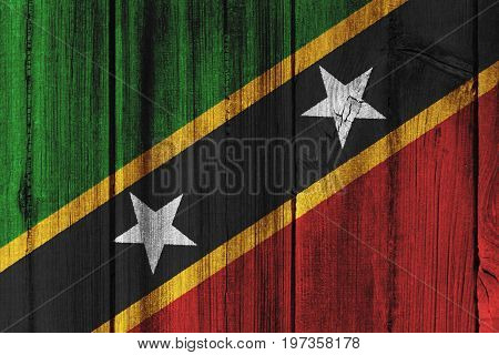 Saint Kitts And Nevis Flag Painted On Wooden Wall For Background