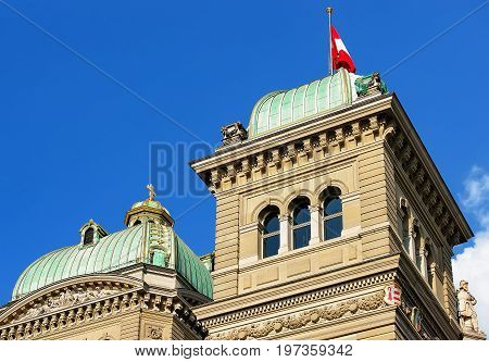 Fragment Of Federal Palace Of Switzerland Towers And Flag Bern