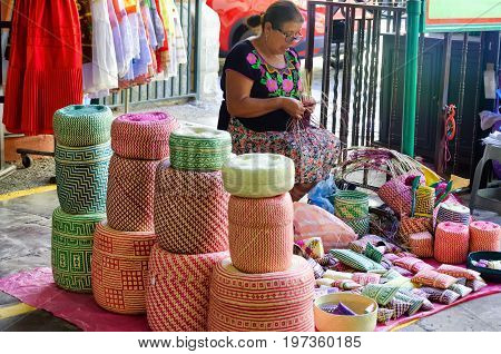 OAXACA MEXICO - MARCH 5: Woman makes traditional baskets for sale at local market in Oaxaca Mexico on March 5 2017