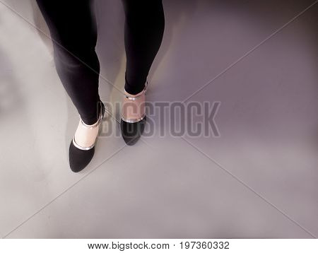Woman dancing with black salsa shoes. Night club