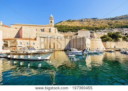 Dubrovnik Fortress And Boats In Port Of Adriatic Sea Croatia
