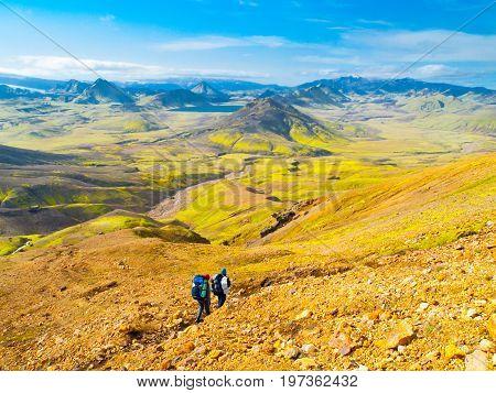 Group of hikers going down the path at Landmannalaugar, Laugavegur trek, Iceland.