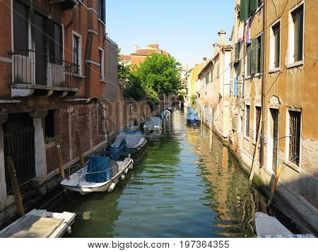 20.06.2017 Venice Italy: Canal with boats and colorful facades of old medieval houses
