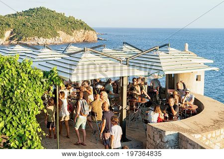 People Chilling Out At Open Cafe At Dubrovnik Fortress Walls