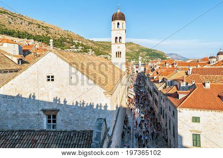 Dubrovnik Croatia - August 19 2016: Franciscan monastery and people on Stradun Street in the Old city of Dubrovnik Croatia