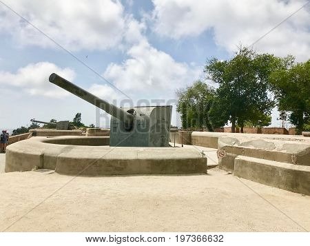 Two spanish cannon at the fort under the sky.