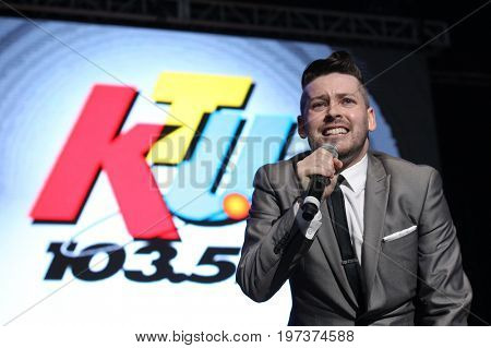 WANTAGH, NY-MAY 31: Singer Justin Baron performs onstage at 103.5 KTU's KTUphoria 2015 at Nikon at Jones Beach Theater on May 31, 2015 in Wantagh, NY.