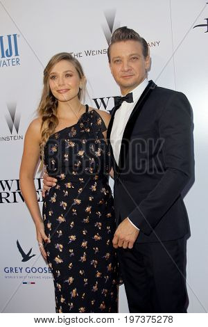 Elizabeth Olsen and Jeremy Renner arrive at the Weinstein Company's