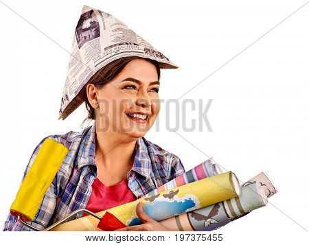 Repair home elderly woman holding paint roller for wallpaper. Happy senior woman in newspaper cap renovation apartment on isolated. Female took loan for repairs and is very joy.