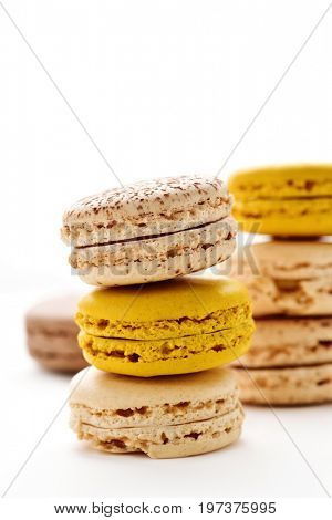 some stacks of appetizing macarons with different colors and flavors on a white background