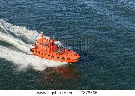 Helsinki, Finland-July 10, 2017: Pilot boat bringing pilot to the American Holland cruise ship Zuiderdam