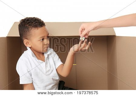 Cute little boy asking for handout on white background. Poverty concept