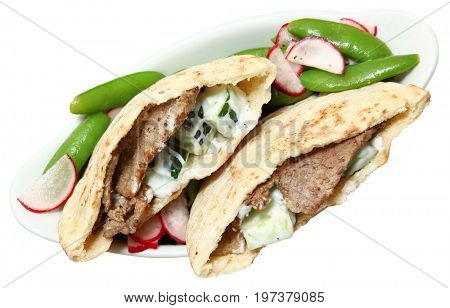 Mediterranean Middle Eastern Fusion Marinated Beef Pita with Radish and Snap Pea Salad and a Cucumber Yogurt Dressing