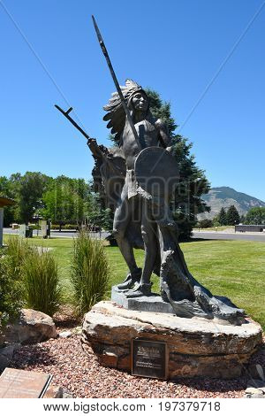 CODY, WYOMING - JUNE 24, 2017:  Washakie Chief of the Shoshone Statue. The sculpture by R V Greeves is at the Buffalo Bill Center of the West.