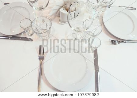 Blurred image serving a restaurant table before the event. Toned image