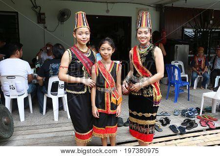 KUCHING, SARAWAK MALAYSIA - JUNE 1, 2017: Beautiful local women from the Bidayuh ethnic in Kuching sarawak wearing traditional costume and accessories