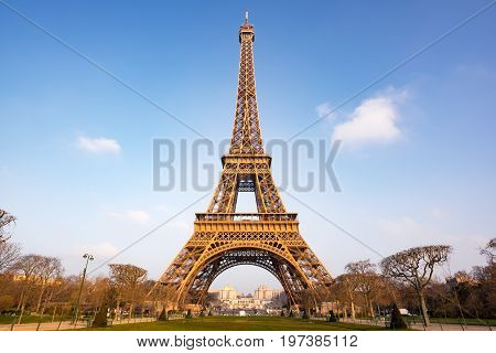 Eiffel Tower Against Blue Sky And White Clouds In Paris, - Morning Light
