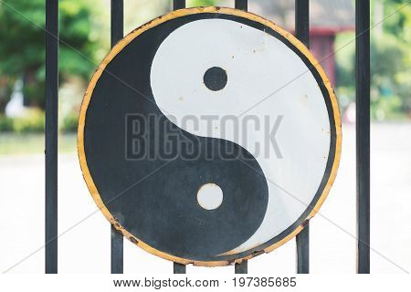 Ying and Yang symbol hang on the gate of a Taoist temple in Chengdu China