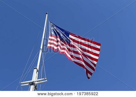 The great garrison flag a replica of the 1812 flag flies at Fort McHenry in Baltimore Maryland.