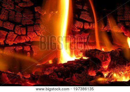 Fire flames in fireplace wood warm hot in cosy in winter embers
