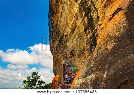 Sigiriya or Sinhagiri Lion Rock an ancient rock fortress located in the northern Matale District near the town of Dambulla in the Central Province Sri Lanka. Stairs and entrance to the rock