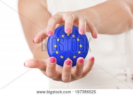 Two Woman Hands Protecting European Union Flag Earth Globe Sphere on a white background.