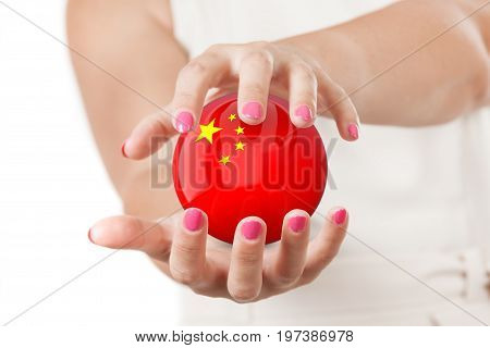 Two Woman Hands Protecting China Flag Earth Globe Sphere on a white background.
