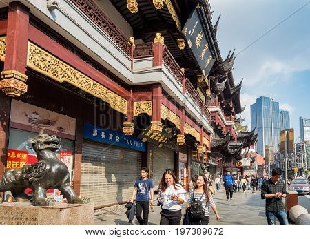 Shanghai, China - Nov 6, 2016: Fangbang Middle Road - Buildings with faithfully restored traditional Chinese architectural designs. Old Shanghai view captured from the street.