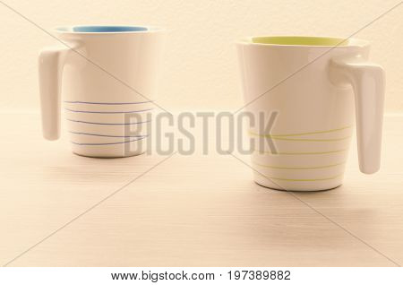Coffee cups for coffee time on wooden background