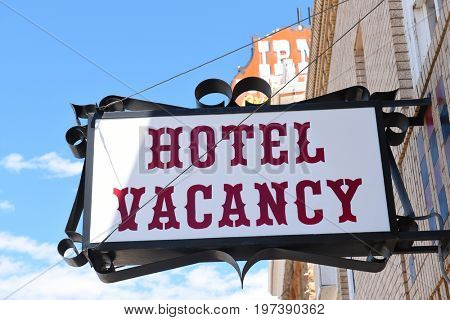 CODY, WYOMING - JUNE 24, 2017: The Irma Hotel vacancy sign. Built by William F. Buffalo Bill Cody, the city's co-founder and namesake who named it after his daughter Irma Cody.