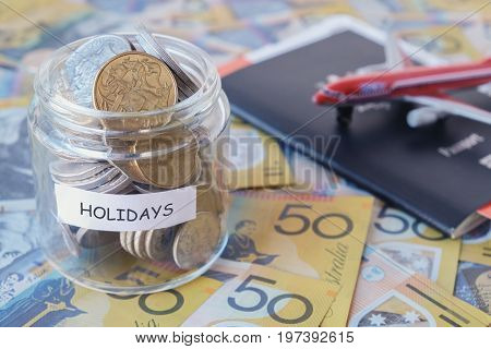 Australian money in HOLIDAYS jar with passport
