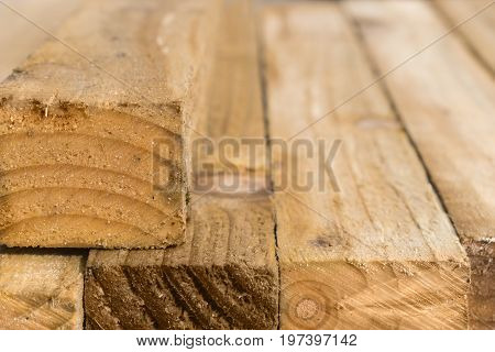 Close up of a pile of wooden battens with a blurred background for copy space