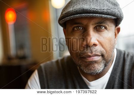 Mature African American man sitting in a coffee shop.