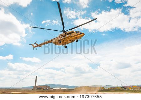 civil golden russian MI-8 helicopter landing in Russia